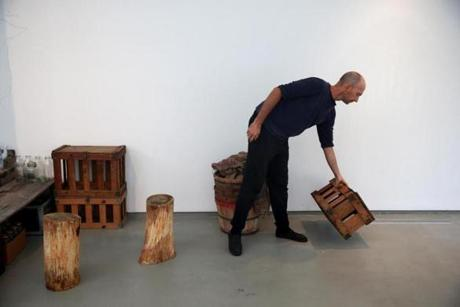 "In a deCordova gallery, Fritz Haeg works on the indoor part of ""Domestic Integrities,"" which will display the fruits of the outdoor part, Haeg's vegetable garden in the parking lot."