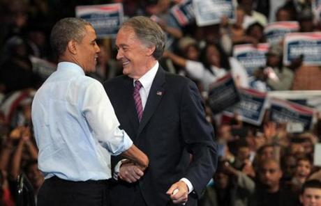 Obama and Markey shook hands during the rally at the Reggie Lewis Track and Athletic Center in Roxbury.