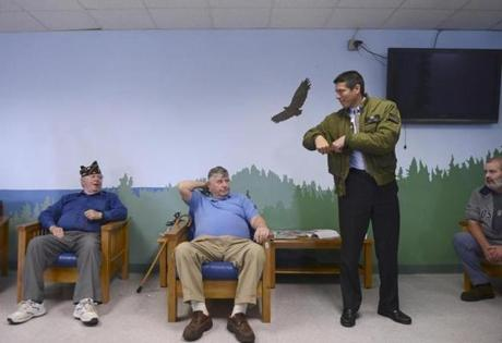 Veterans Robert Carney McHugh of Scituate (left), Dick Campana of Wellesley, and Tom Miller of Dorchester (right) watched as Republican Senate candidate Gabriel Gomez got ready to speak at   the Soldiers Home in Chelsea.