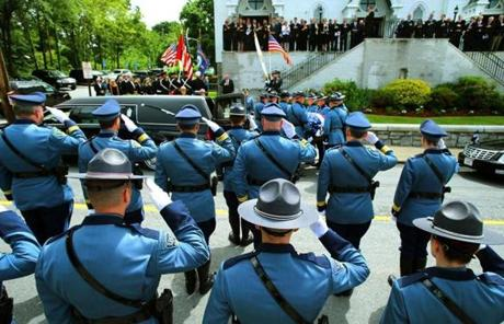 State Police saluted as Cellucci's casket was carried into the church.