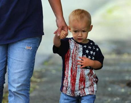 Kenneth Durkin, 2, and his mom Anne were outside the church during the funeral.