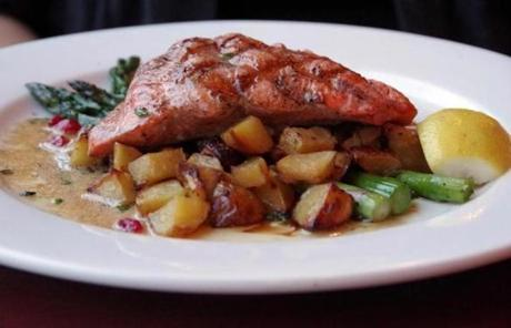 Elliot's Oyster House on Seattle's waterfront is known for its seafood, including Pacific salmon dishes.