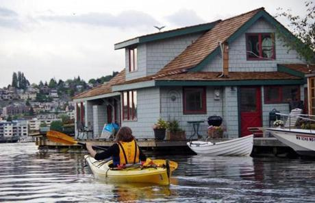 Rent a kayak and explore the area's house boats.