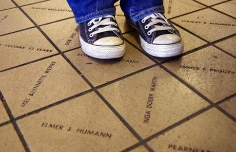 More than 45,000 engraved tiles make up the floor at Seattle Pike Place Market.