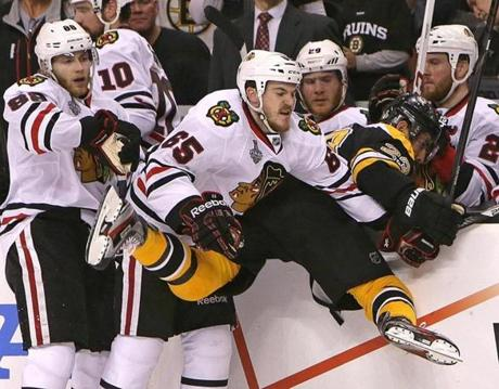 Chicago's Andrew Shaw sent Boston's Chris Kelly over the boards in the first period.