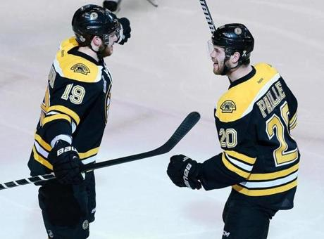 Daniel Paille, right, being congratulated by Tyler Seguin, scored the other goal for the Bruins.