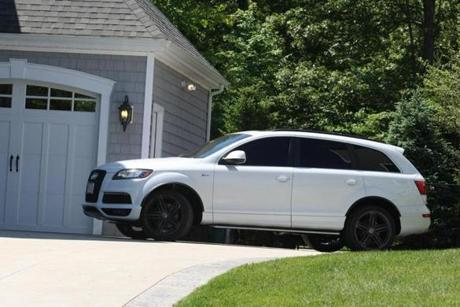 A man believed to be Aaron Hernandez backed out of the home in a white Audi SUV Thursday.