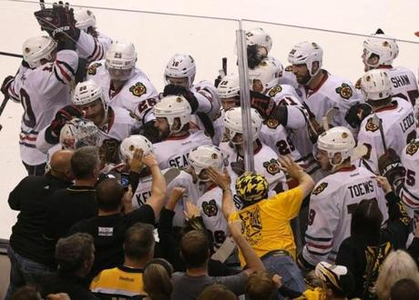 The Blackhawks celebrated on the TD Garden ice after beating the Bruins 6-5 in overtime in Game 4.