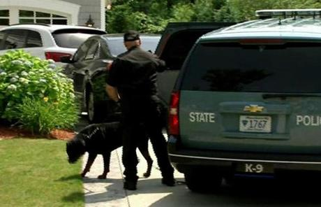 Police brought two police dogs and what appeared to be equipment for analyzing a crime scene.