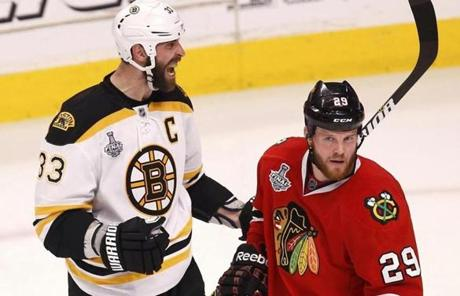 Zdeno Chara (left) celebrated after scoring on the Blackhawks in the third period.