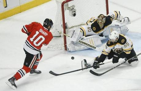 Boychuk (right) helped goalie Tuukka Rask defend.