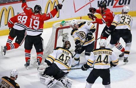 Kane scored the game's first goal as David Krejci (left) and Chara tried to defend in the first period.