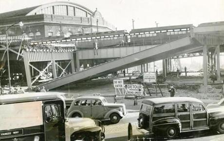 May 23, 1952:  A 96-foot, 200-ton span of 17 girders collapsed into Sullivan Square - two minutes after two M.T.A. buses loaded with passengers had passed under the 40-foot high structure. The overpass was being designed to carry traffic from Mystic Ave and Broadway, Somerville over Sullivan Sq. to Rutherford Ave. in Charlestown, and connect with the Boston Central Artery and Mystic River Bridge.
