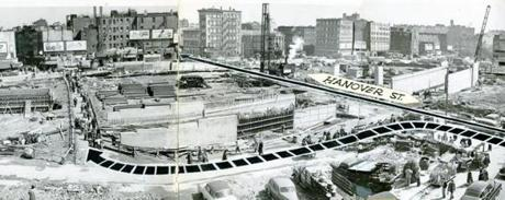 April 8, 1953: Demolition began in the North End in the first few months of 1953 and workers began driving the concrete piles that supported the steel columns that would hold up the elevated roadway. This published graphic showed the pedestrian route to navigate parallel to Hanover Street which was closed to traffic and pedestrians.