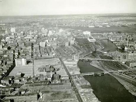 Undated photo: An aerial view of Boston before construction of the Central Artery looking from south to north. The present day Pine Street Inn building can be seen tin the lower middle of the photo. Originally that building was Fire Department Headquarters until 1951. The building was modeled after the Palazzo Vecchio in Florence, Italy and the Pilgrim Monument in Provincetown, MA, and featured a tall drill tower that was used for training fire department recruits.