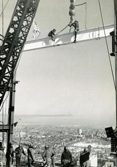 February 1 1963 / fromthearchive / Prudential Insurance Co. photo / Daring steel workers hoisted cable from a symbolic white beam which they riveted into position to mark the final stage of the traditional