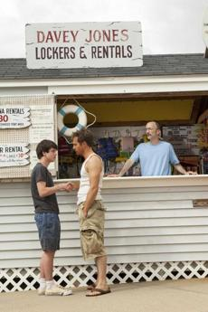 "From left: Liam James, Sam Rockwell, and Jim Rash at the Water Wizz water park in a scene from ""The Way, Way Back."""