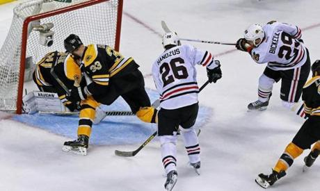 Bryan Bickell, right, beat Tuukka Rask to tie the game at 2-2 with 1:16 left in the game after the Blackhawks took a 6-5 advantage in their end of the ice.