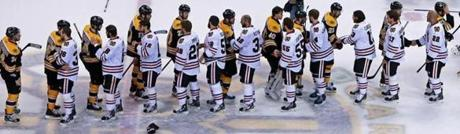 The Bruins and Blackhawks met at center ice for the customary post-series handshake after the game.