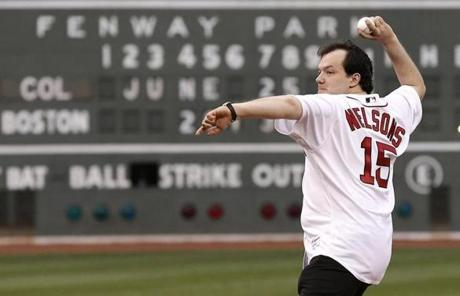 Nelsons threw the first pitch, arcing the ball a good 25 feet over the catcher and into the hands of a photographer.