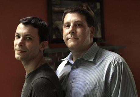 Genesio Oliveira (left) and Tim Coco have struggled to attain legal residency for Oliveira, who is a native of Brazil, since they got married in Massachusetts eight years ago