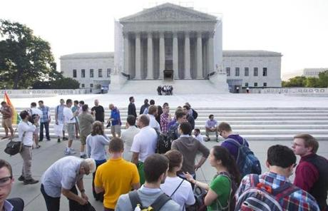 Members of the public waited in line to enter the Supreme Court to hear their rulings on two gay rights issues.