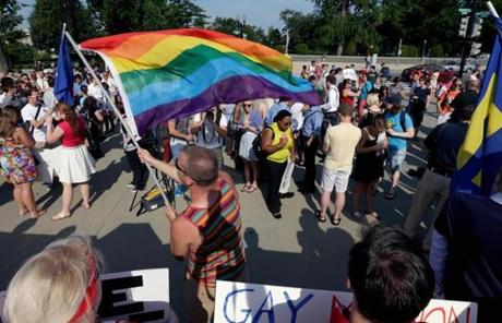 Gay rights supporter Vin Testa waved a rainbow flag outside the US Supreme Court building.