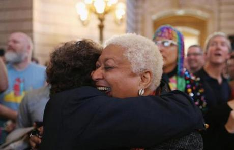 A couple celebrated in San Francisco upon hearing the Supreme Court struck down the Defense of Marriage Act.