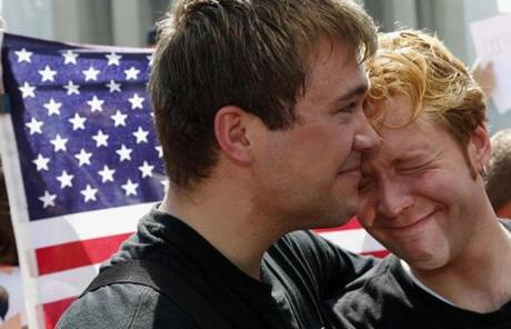 Michael Knaapen (left) and his husband, John Becker, embraced outside the Supreme Court in Washington, DC.