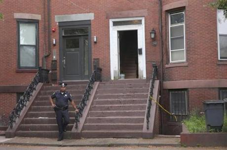 Boston police investigated the South Boston unregulated sober home where a woman was found dead Wednesday night.