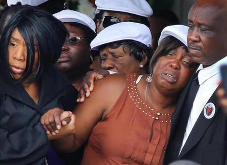 Odin Lloyd's mother, Ursula Ward, was helped from the Holy Spirit Church in Mattapan after her son's funeral service.