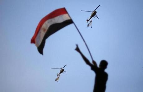 Egyptian military helicopters circled over Tahrir Square during a protest demanding that Egyptian President Mohamed Mursi resign.