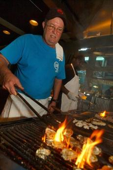 IBubba Hiers, who is Paula Deen's brother and subject of a lawsuit, grills oysters at his restaurant in Savannah, Ga., in 2006.