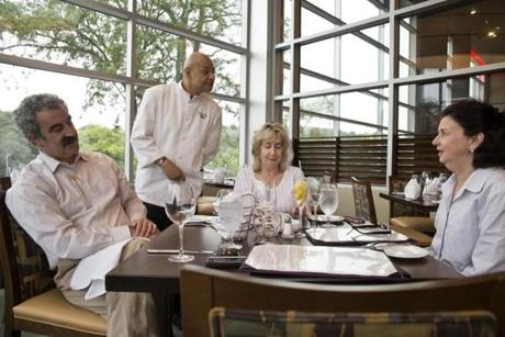 Waiter Miguel Mendez checked in on (from left to right) Gerry Goldman, Liz Goldman, and Meredith Pilla at Davio's Cucina.