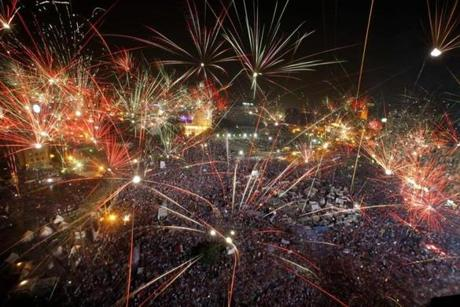 Fireworks lit up the sky above Tahrir Square on Wednesday as tens of thousands of opponents of Mohammed Morsi celebrated his removal by military officers.
