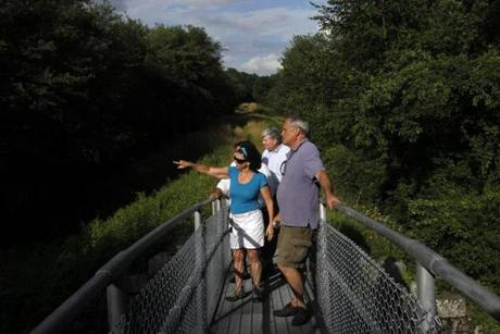 Framingham Selectwoman Laurie Lee with executive director of the MWRA Fred Laskey and state Representative Chris Walsh along a section of the aqueduct that will be opened to the public.