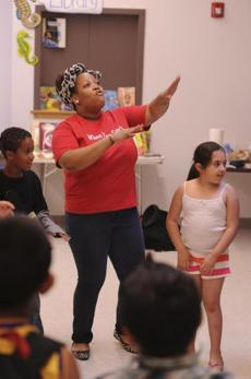 At the Somerville school, Breanya Hogue leads a class in an exercise called harambee.