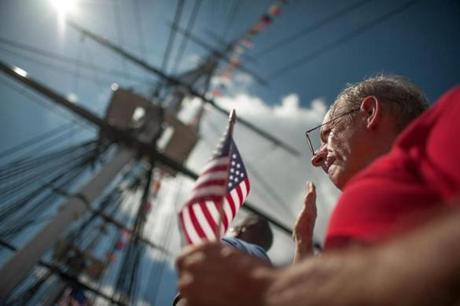 Mike Killory, 59, a new US citizen originally from Halifax, Nova Scotia, took the oath of allegiance during a Fourth of July naturalization ceremony aboard the USS Constitution.