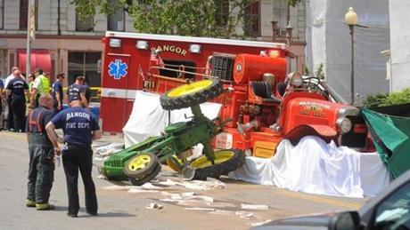 The driver of a tractor was killed when his vehicle was hit from behind by an antique fire truck as Bangor celebrated the Fourth of July with a parade.