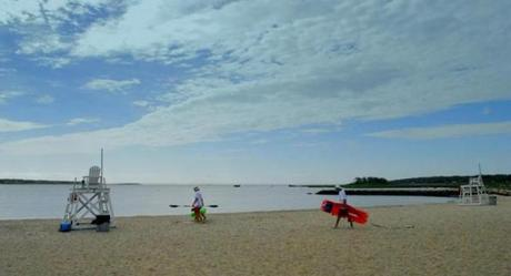 Lifeguards arriving in the morning at Silvershell Beach in Marion.