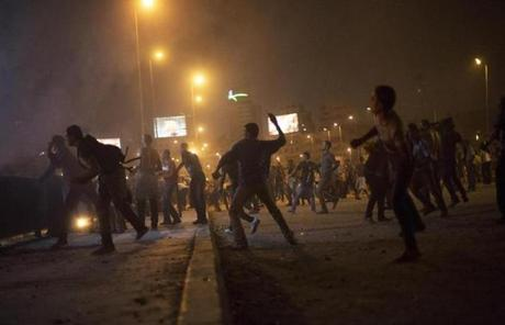 In cities across the country, clashes erupted as Morsi supporters tried to storm local government buildings or military facilities.