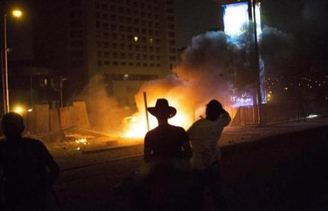 Opponents of ousted President Mohammed Morsi clashed with his supporters near Tahrir Square.