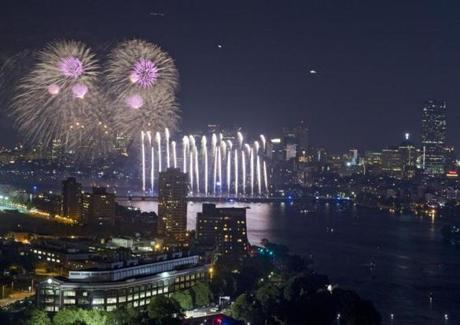 The fireworks over the Charles River  were visible from a rooftop at Boston University.