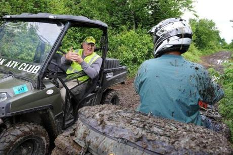 Harry Brown (left) stopped on the ATV trail in Conway, N.H. He wants more ATV tourism.
