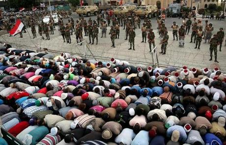 Many of Mohammed Morsi's supporters prayed next to the Republican Guard's headquarters.