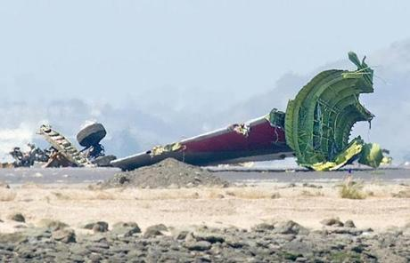The detached tail and landing gear of Asiana Flight 214 rested on the tarmac.
