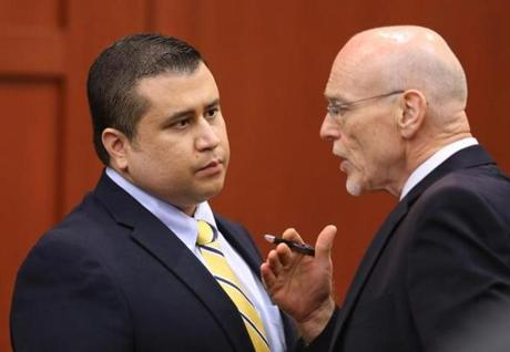 Zimmerman and his attorney conferred during a recess in the court room.