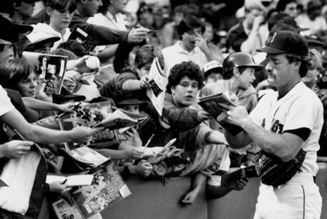 September 1, 1986: Red Sox third baseman Wade Boggs signed autographs before the game with the Texas Rangers. The Sox, in first place, beat the Rangers 6-4. The fan enthusiasm for the Sox didn't wane as the Sox ultimately defeated the California Angels to win the American League Championship. Unfortunately they lost the World Series to the New York Mets, but 750,000 fans still turned out for a parade in their honor.