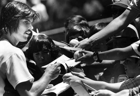 June 25, 1978:  Red Sox pitcher Dennis Eckersley signed autographs before the Sox game with the Baltimore Orioles. Not to worry, he wasn't wearing out his pitching arm as Luis Tiant was the starter and got the 8-3 win over the Birds.