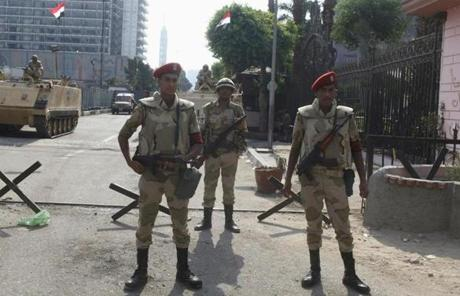 Egyptian troops stood guard in front of a museum in Cairo's Tahrir Square on Tuesday.